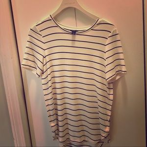 A short sleeve top with narrow black stripes.